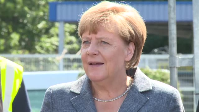 German Chancellor Angela Merkel says there will be no tolerance for 'shameful and vile' anti migrant violence facing down a noisy far right protest...