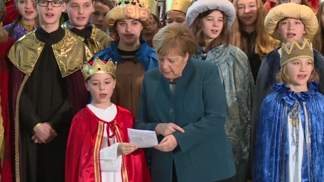 german chancellor angela merkel sings with carol singers from all over the country to promote the sternsinger project which collects money for... - angela merkel stock videos & royalty-free footage