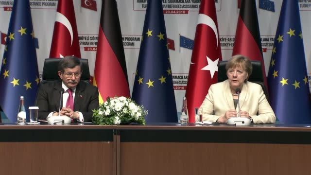 german chancellor angela merkel speaks during a joint press conference of turkey-eu aid program for syrian refugees with turkish prime minister ahmet... - トルコ首相点の映像素材/bロール