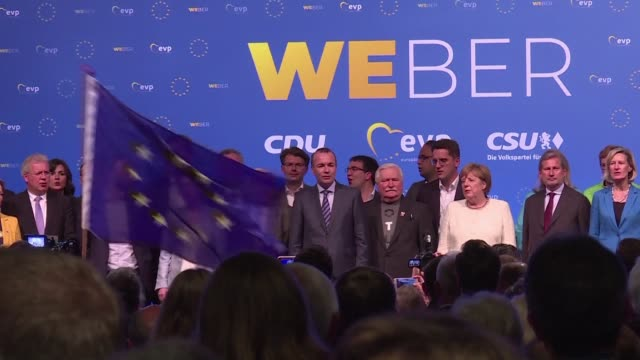 vídeos de stock, filmes e b-roll de german chancellor angela merkel takes part in the last campaign rally by the eu wide centre right epp group ahead of the european elections saying we... - alta baviera