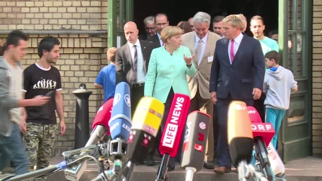 German Chancellor Angela Merkel visits a refugee centre in Berlin as Germany expects to welcome 800000 asylumseekers this year