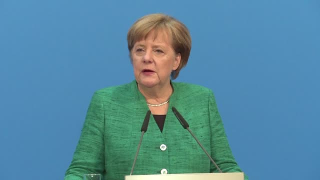 German Chancellor Angela Merkel's conservatives and the Social Democrats sealed a deal on a new coalition Wednesday potentially ending four months of...
