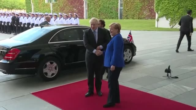 german chancellor merkel greets british pm johnson as he visits berlin to kick off a marathon of tense talks with key european and international... - chancellor of germany stock videos & royalty-free footage
