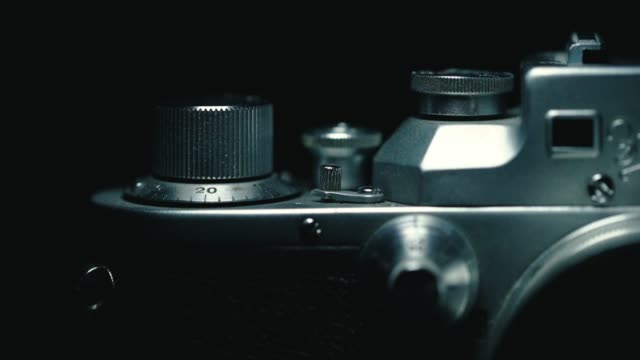german classic vintage camera, black background, - analog stock videos and b-roll footage