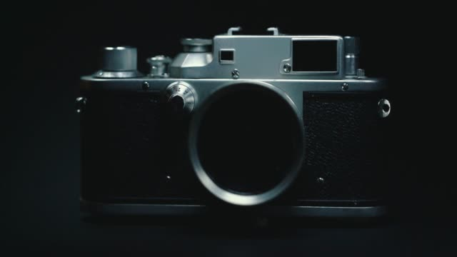 german classic vintage camera, black background, - photography stock videos & royalty-free footage
