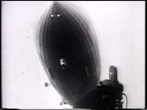 German commercial passenger rigid airship Hindenburg arriving at Lakehearst TU UNDER Zeppelin ship Explosion ship collapsing hydrogen leaking men...