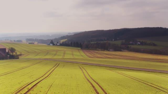german farmland in early spring - aerial view - north rhine westphalia stock videos & royalty-free footage