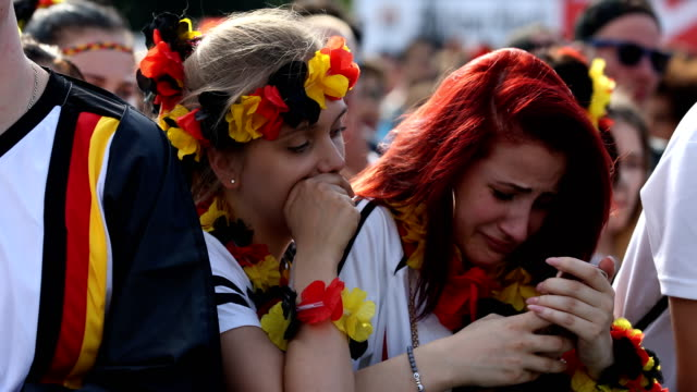 german female fan is crying after germany lost the 2018 fifa world cup russia group f match against korea republic at the kazan arena in kazan russia... - fan enthusiast stock videos & royalty-free footage