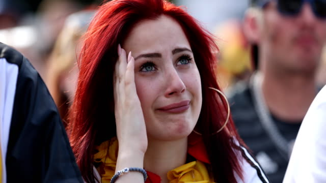 german female fan is crying after germany lost the 2018 fifa world cup russia group f match against korea republic at the kazan arena in kazan,... - international team soccer stock videos & royalty-free footage