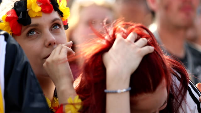 german female fan is crying after germany lost the 2018 fifa world cup russia group f match against korea republic at the kazan arena in kazan,... - fußballweltmeisterschaft stock-videos und b-roll-filmmaterial
