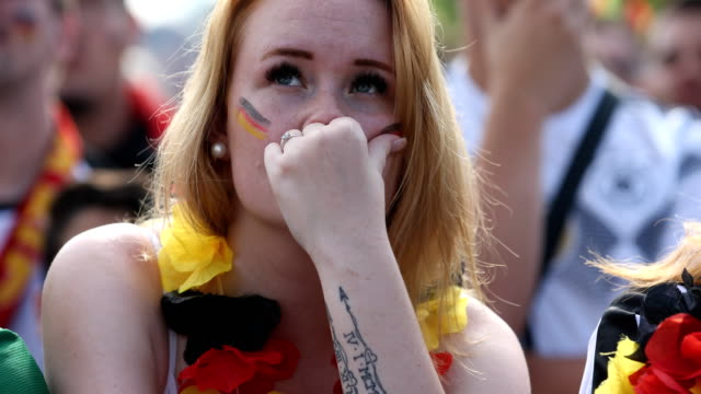 german female fan with a scarf in the colors of the german flag is crying after germany lost the 2018 fifa world cup russia group f match against... - neckwear stock videos and b-roll footage