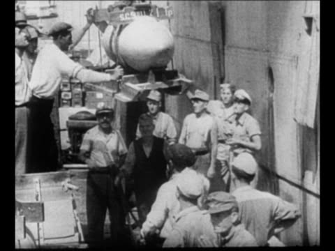 vidéos et rushes de cu german field marshal erwin rommel smiles during world war ii / montage crews roll barrels move crates load bombs and train parts onto ship /... - wehrmacht