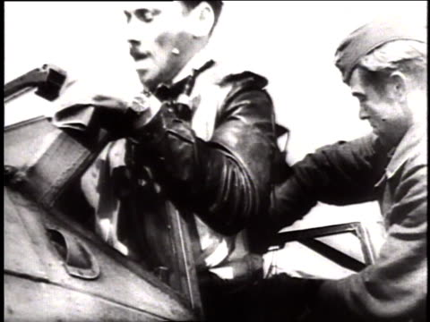 german fighter pilots climbing into planes and cranking engines as propellers start and sirens sound in warning / germany - air raid siren stock videos & royalty-free footage
