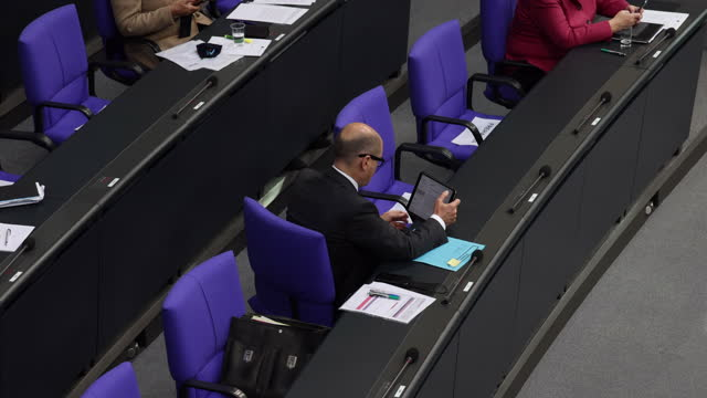german finance minister olaf scholz attends a debate at the bundestag during the coronavirus pandemic on october 29, 2020 in berlin, germany. the day... - note pad stock videos & royalty-free footage