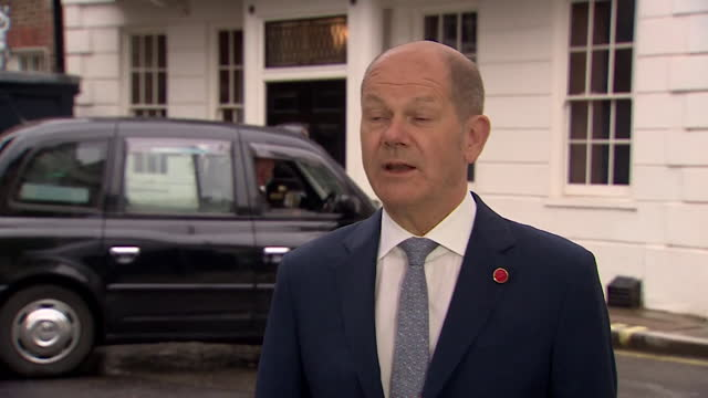 """german finance minister olaf scholz saying the new international tax system """"will really change the world"""" - global business stock videos & royalty-free footage"""