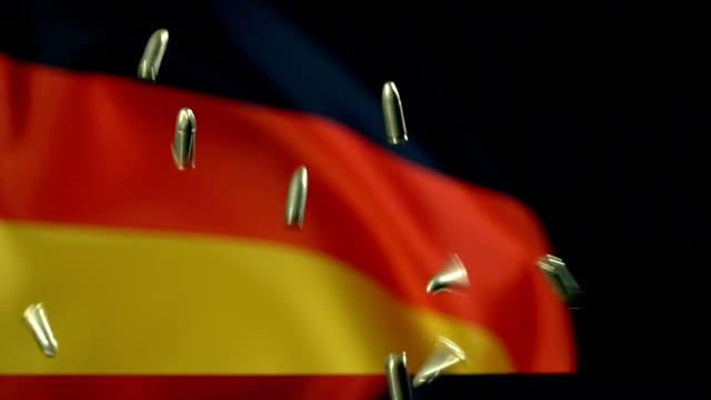 german flag behind bullets falling in slow motion - german language stock videos & royalty-free footage