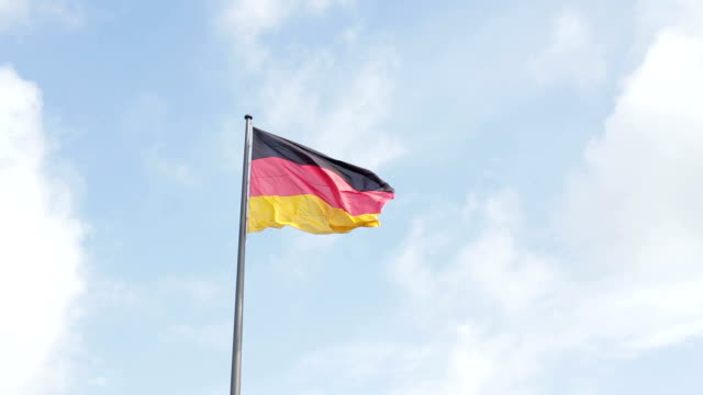 german flag fluttering in the wind - german flag stock videos & royalty-free footage