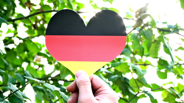 german flag on heart shape - german flag stock videos & royalty-free footage