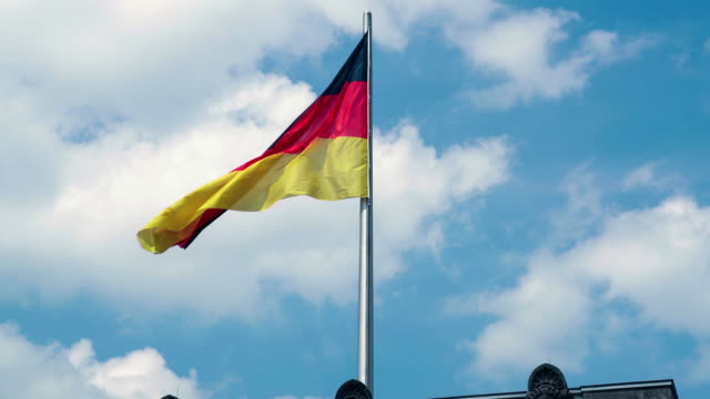 german flag on top of the reichstag building, berlin, germany - german flag stock videos & royalty-free footage