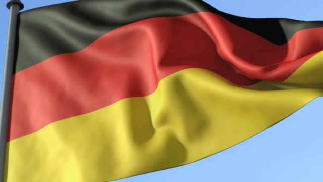 cu, german flag waving against blue sky - german flag stock videos & royalty-free footage