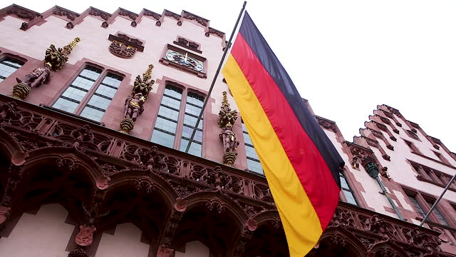 german flag waving in the wind / frankfurt, germany - hanging stock videos & royalty-free footage