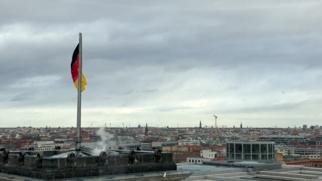 german flag waving on a building - german flag stock videos & royalty-free footage