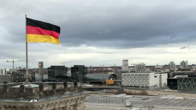 german flag waving on the roof of city hall - german flag stock videos & royalty-free footage