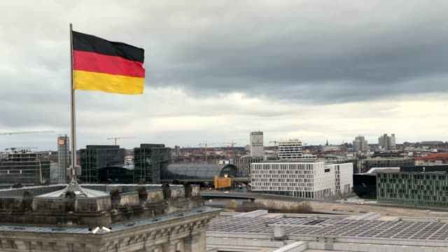 german flag waving on the roof of the reichstag - german flag stock videos & royalty-free footage