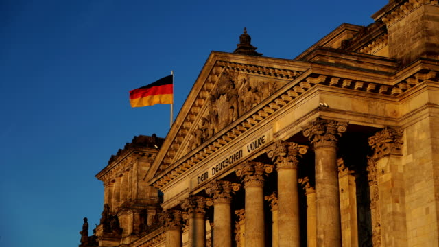 german flags at reichstag, berlin, germany - german flag stock videos & royalty-free footage
