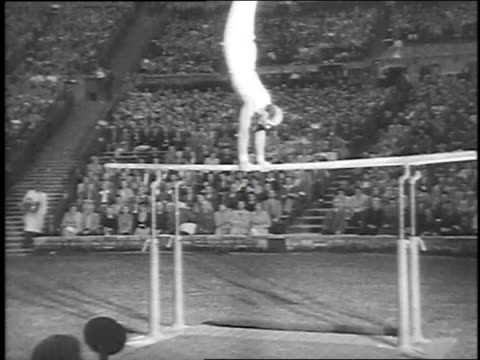 german gymnast performing routine on the parallel bars / berlin, germany - 1951 stock videos & royalty-free footage
