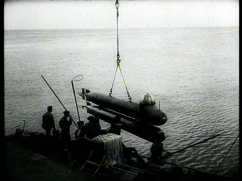 german kriegsmarine demonstrating new weapon manned torpedo military staff being awarded medals of distinction / germany - kriegsmarine stock videos & royalty-free footage