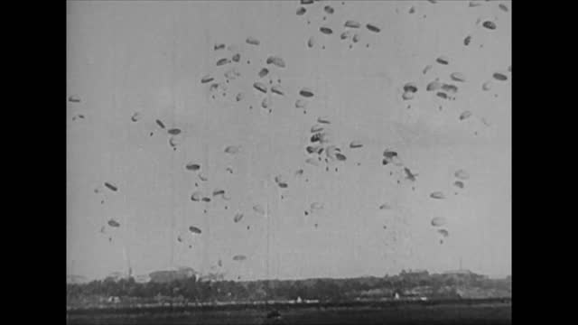 vidéos et rushes de german land troops destroying border fortification obstacles/ german paratroops landing at rotterdam/ german army advancing through the netherlands - 1940