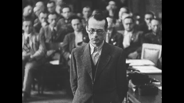 german language throughout / a thin man with eyeglasses is seen over the head of people's court president roland freisler at his bench in the... - legal trial stock videos & royalty-free footage