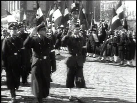 german leaders standing on a balcony / german troops marching in the street / crowds of people cheering / - axis powers stock videos & royalty-free footage