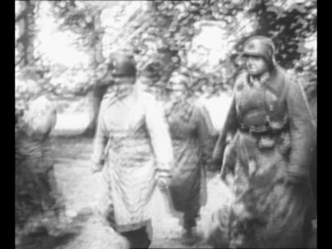 german lt gen karlwilhelm von schlieben and subordinate walter hennecke walk with american officers as they arrive to surrender command to the allies... - subordination stock videos & royalty-free footage