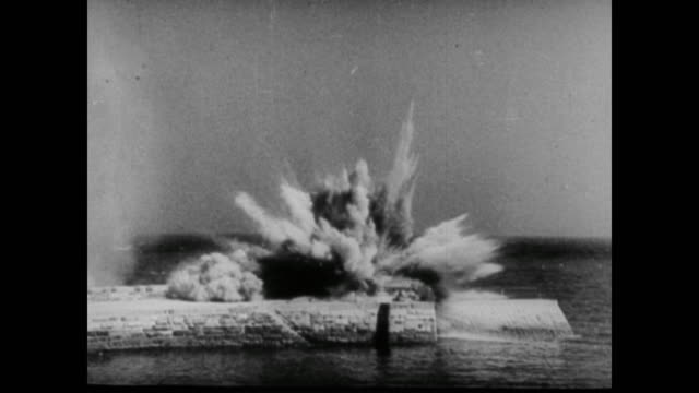 german luftwaffe continue to bomb the british coastline despite losing several hundred planes - 空爆点の映像素材/bロール