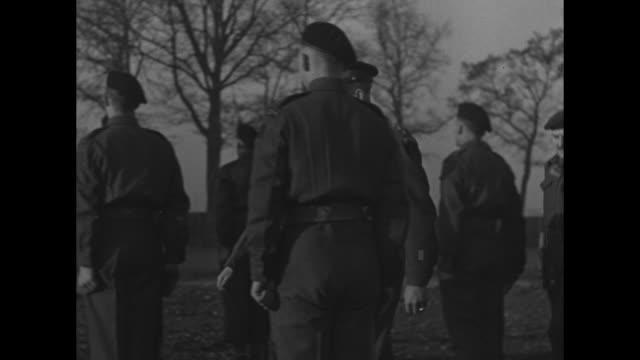 cu german major general franz vaterrodt frowning dejectedly at being captured / ms highranking german pows / mls german pows lined up in front of... - prigioniero di guerra video stock e b–roll