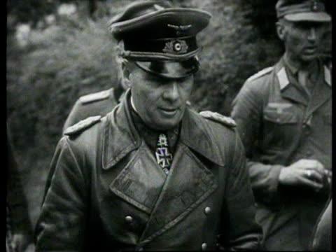 german marshal in company of other officers leaving house, german tanks and infantrymen advance through area / france - infanteri bildbanksvideor och videomaterial från bakom kulisserna