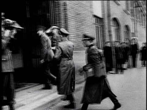 german military officials getting out of car under armed guard / german officers walk into building / military officials seated at conference table /... - ヨーロッパ戦勝記念日点の映像素材/bロール