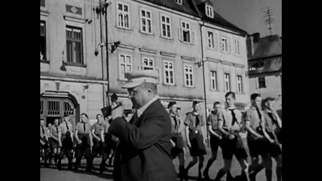 german military youth organisation members marching on city street / hitler's speech - youth organisation stock videos & royalty-free footage