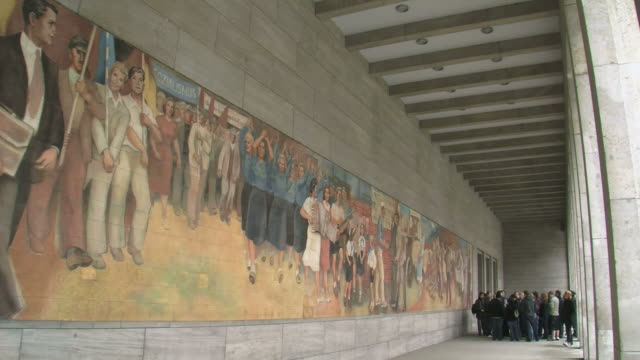 ws pan german ministry of finance and old wall paintings of german democratic republic at leipziger strasse street / berlin, germany - female likeness stock videos & royalty-free footage