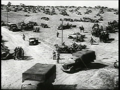 vídeos de stock, filmes e b-roll de german mobile units gather in open plain trucks panzer tanks cavalry form 'countercharge' - polônia