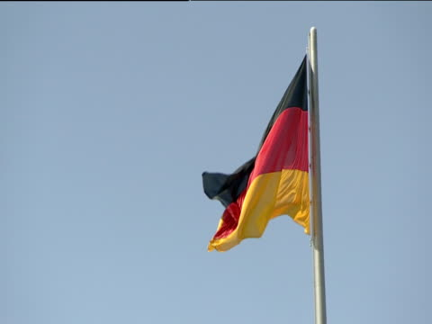 German national flag flying in light breeze Berlin