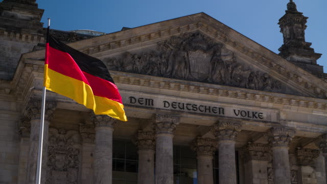 German National Flag in front of Reichstag in Berlin - Germany