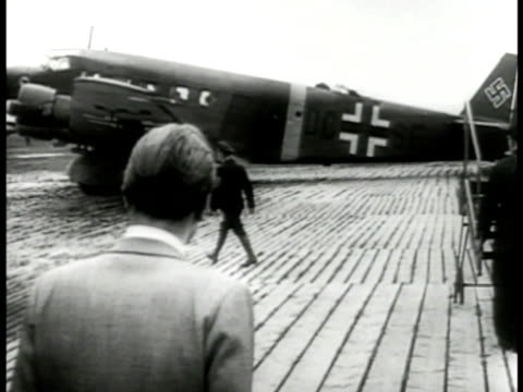 German Nazi airplane taxiing ground crew waiting FG MS Benito Mussolini down stairs off airplane shaking hands w/ Hitler Airport Germany