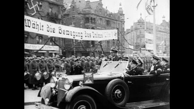 vídeos de stock, filmes e b-roll de german nazi banners flying on polish buildings nazi germany propaganda minister joseph goebbels riding in convertible vs nazi banners in city... - polônia