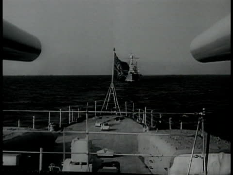 german nazi flag at rear of ship destroyer ship at sea bg. german naval men walking off ship ramp gang plank crowd of navy men still on ship bg. wwii - nazi swastika stock videos & royalty-free footage