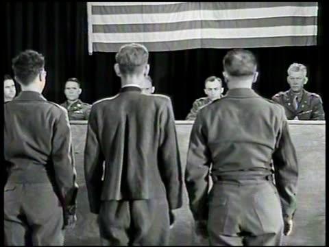 german nazi franz strasser & interpreter standing. standing before u.s. military commission, finding strasser guilty of all charges. strasser & two... - hängen stock-videos und b-roll-filmmaterial