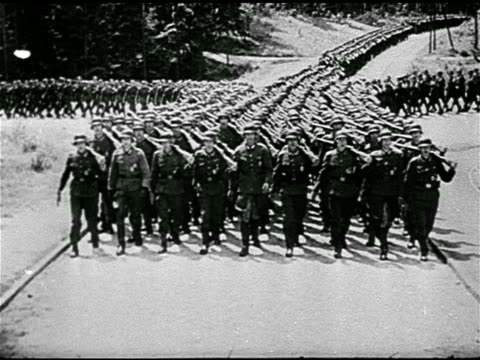 german nazi hitler saluting soft focus soldier fg hess ha ws german nazi soldiers marching down road nine abreast cu german boots legs marching - anno 1938 video stock e b–roll