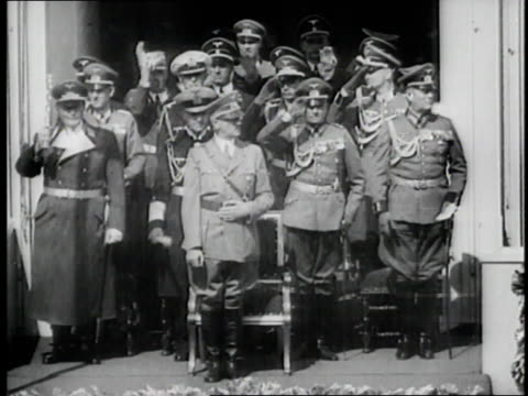 german nazi soldiers goose step past adolf hitler and military officials and give the fascist salute - military parade stock videos & royalty-free footage